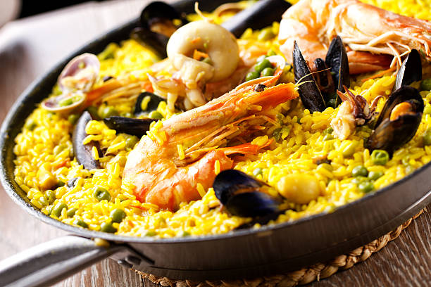 paella. - paella stock photos and pictures