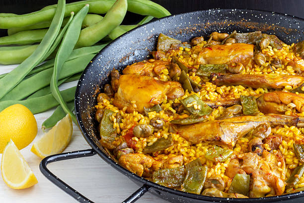 paella valenciana - spanish food - paella stock photos and pictures