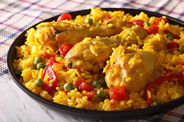 paella with chicken meat and vegetables closeup. horizontal - chicken rice stock photos and pictures