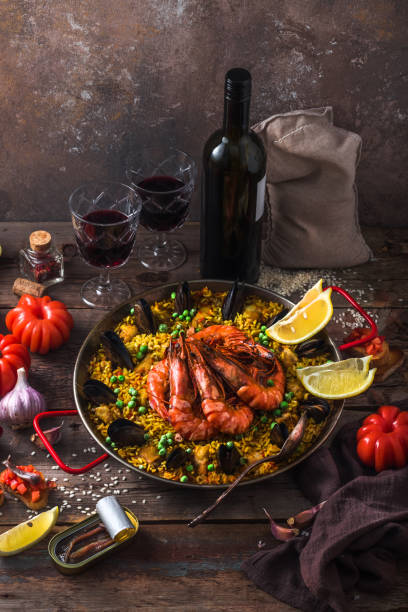 Paella with seafod and checken or paella mixta in a pan stock photo