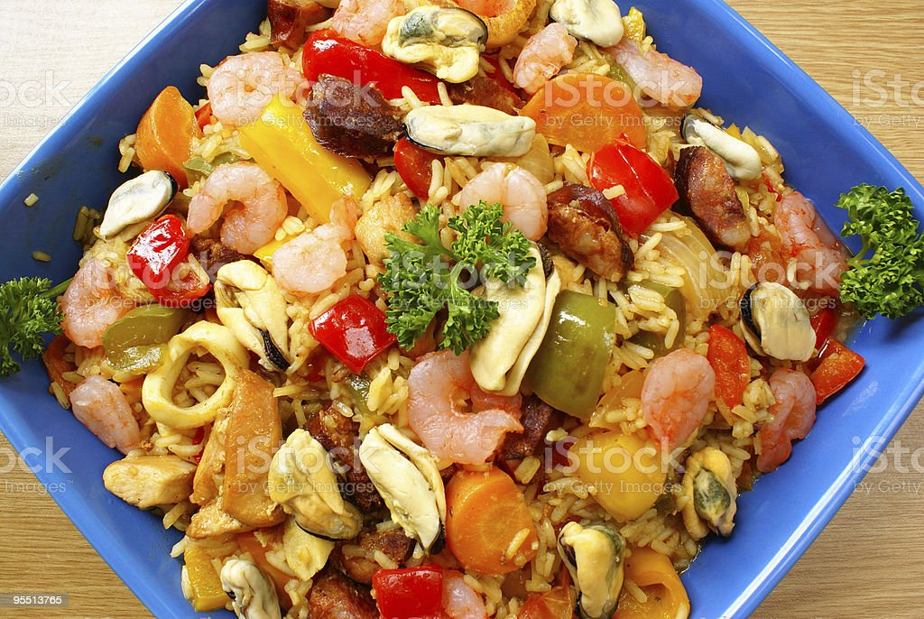 Paella with seafood, chicken and chorizo royalty-free stock photo