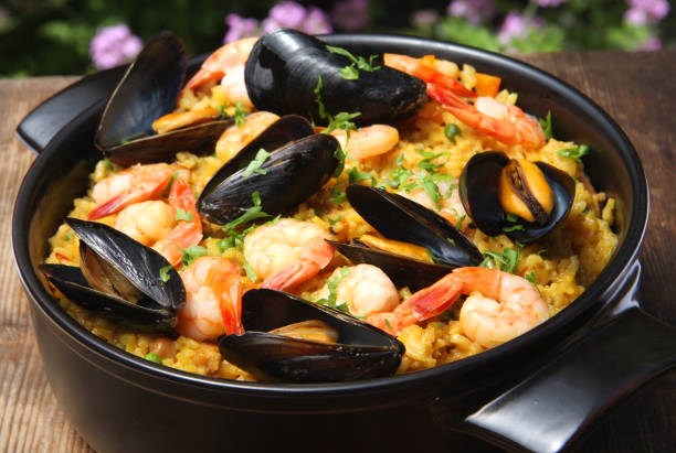paella with seafood - paella stock photos and pictures
