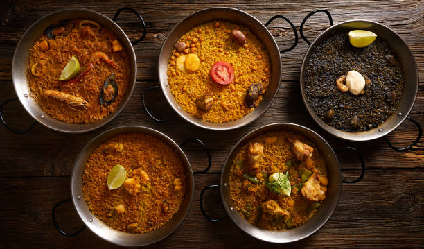 paellas five rice recipes from spain - paella stock photos and pictures