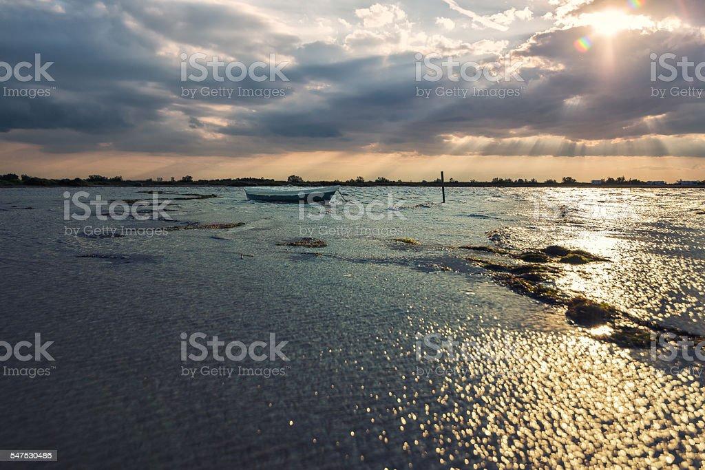 Paesaggio Camargue al tramonto con barca stock photo