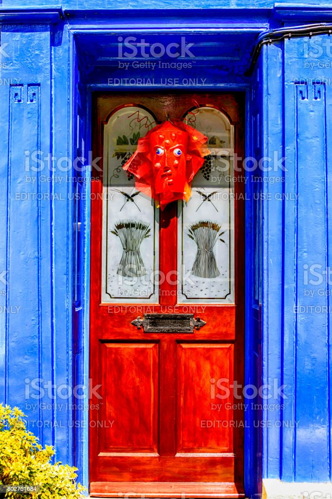 Pagan mask affixed to a house front door in Appledore Devon UK stock photo