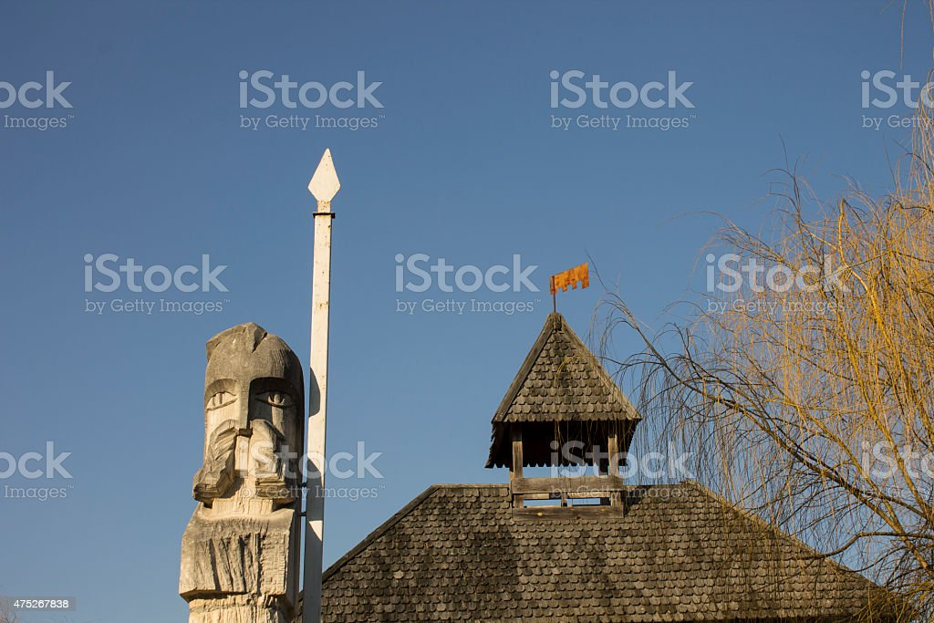 Pagan sculpture and roof of the fortress stock photo