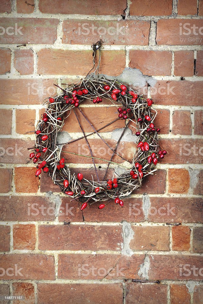 Pagan Yule Pentagram Hanging on Wall royalty-free stock photo
