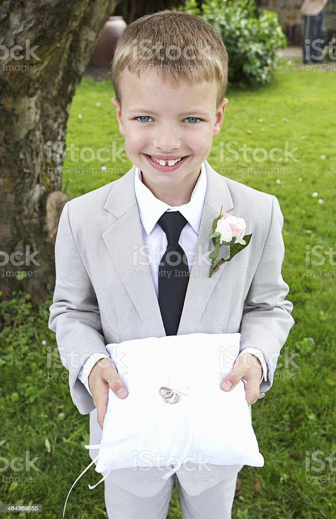 Page Boy Carrying Wedding Ring On Cushion stock photo