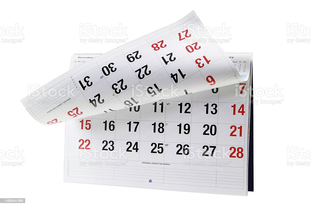 Page of calendar month curls upwards revealing the next page stock photo
