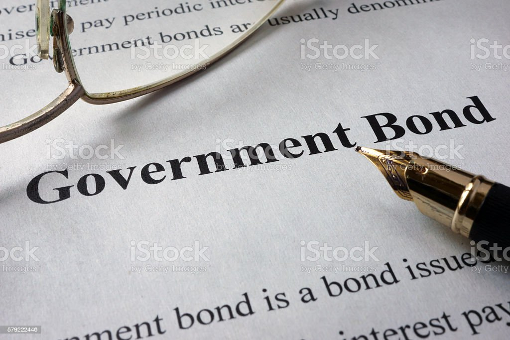 Page of newspaper with words government bonds. stock photo