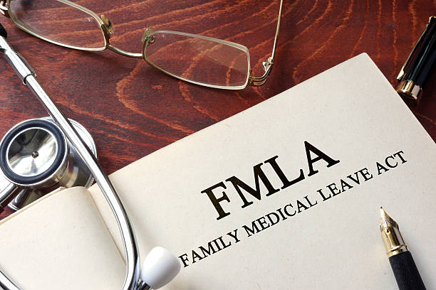 Page with FMLA family medical leave act on a table. - foto stock