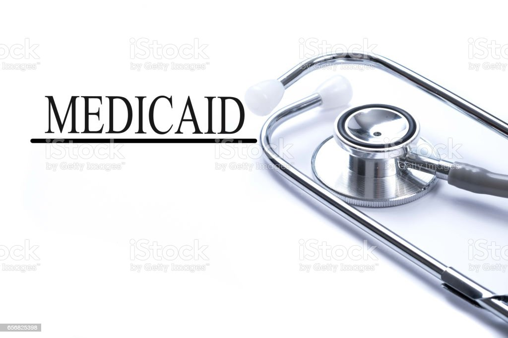 Page with medicaid on the table with stethoscope, medical concept stock photo