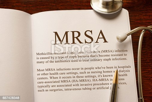 istock Page with MRSA Methicillin-resistant Staphylococcus aureus infection on the table with stethoscope, medical concept 657428348
