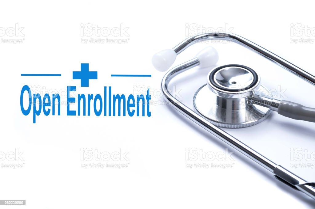Page with Open Enrollment on the table with stethoscope, medical concept. stock photo