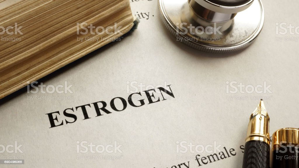 Page with title estrogen and book. Human hormones. stock photo
