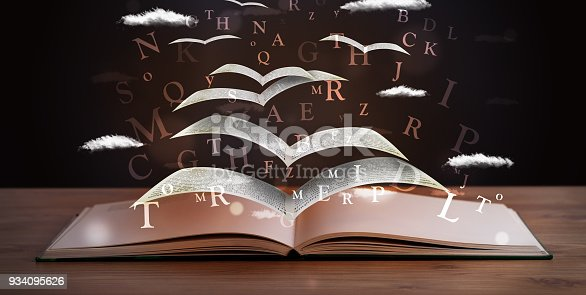 istock Pages and glowing letters flying out of a book 934095626