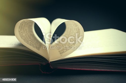 817147678 istock photo pages of a book curved into a heart shape 469334906