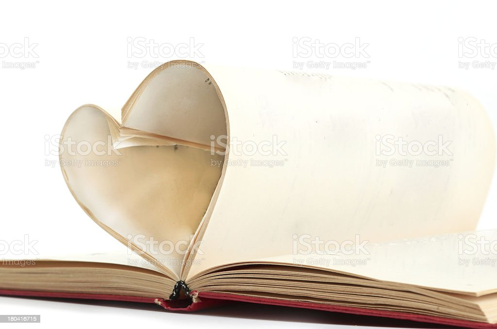 pages of a book curved into  heart royalty-free stock photo
