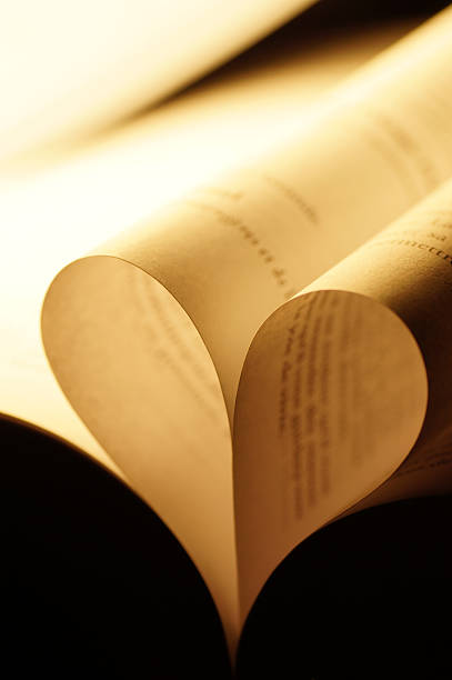 Pages of love : Gold Sheets a book heart shaped stock photo