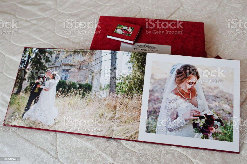 pages of red wedding photobook or wedding album on white background