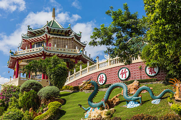 Pagoda and dragon sculpture of the Taoist Temple in Cebu Pagoda and dragon sculpture of the Taoist Temple in Cebu, Philippines.Pagoda and dragon sculpture of the Taoist Temple in Cebu, Philippines. taoism stock pictures, royalty-free photos & images