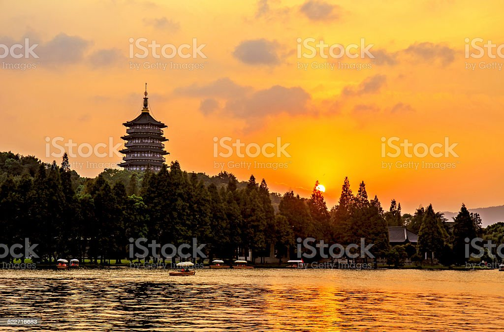 Pagoda of West Lake in Hangzhou at Sunset in China stock photo