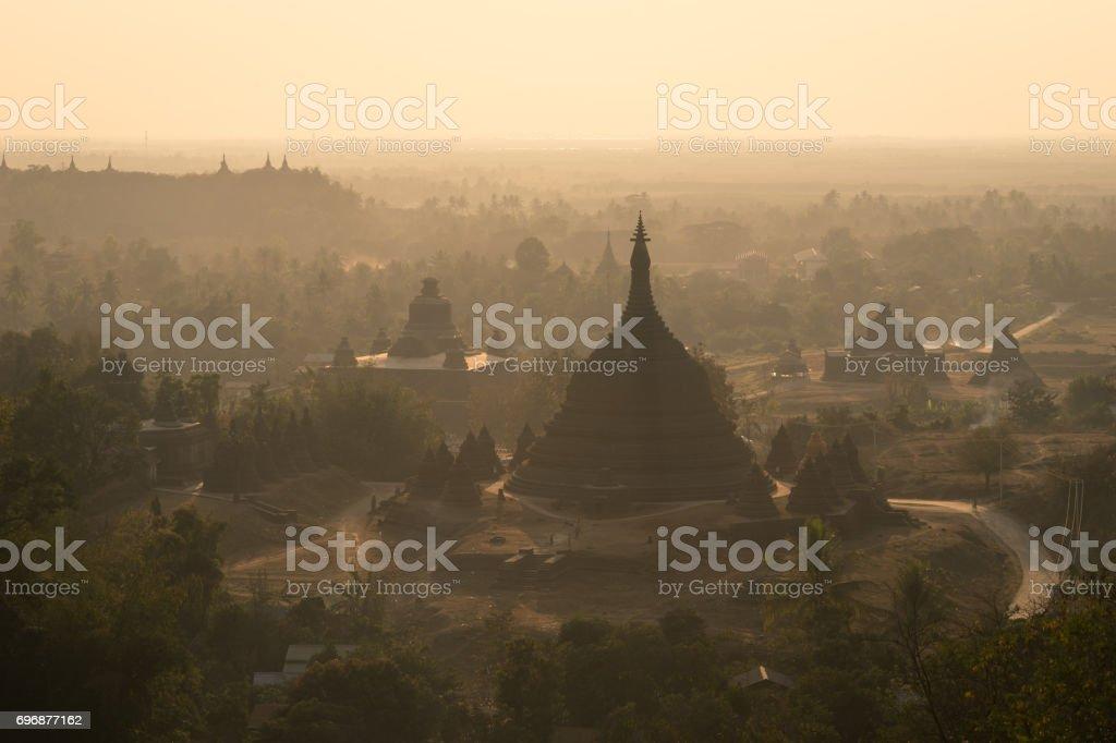 Pagodas and monastery on hill at sunset, north Mrauk U, Rakhine state, Myanmar stock photo