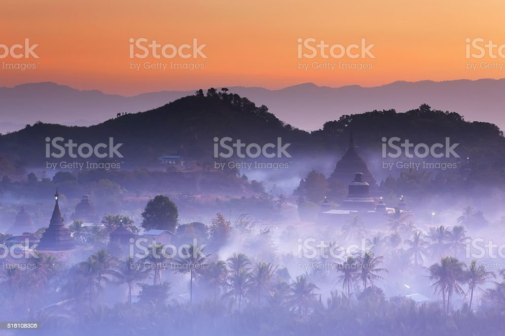 Pagodas with mist at dawn in Mrauk-U, Myanmar stock photo