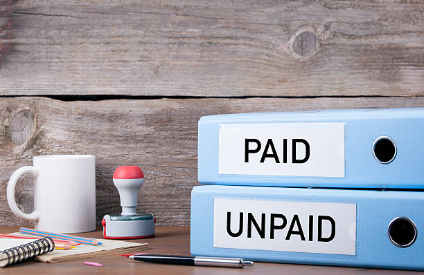 paid and unpaid. two binders on desk in the office - paid stock pictures, royalty-free photos & images