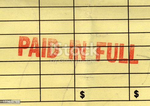 close up of a reciept reading paid in full
