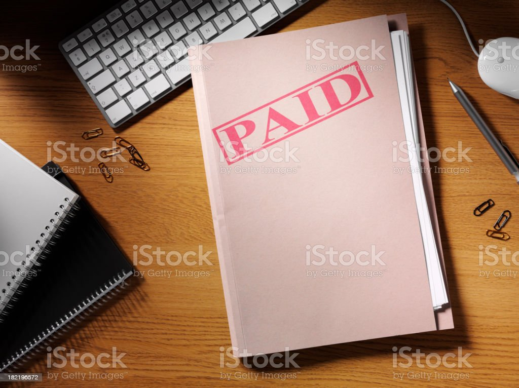 Paid Stamp on a Folder royalty-free stock photo