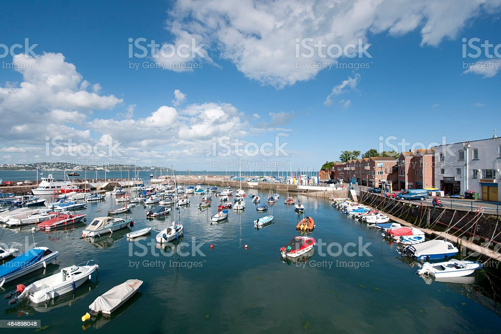 Paignton harbour Devon sunny June with tide in and boats stock photo