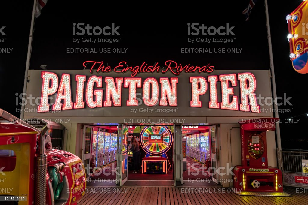 Paignton Pier sign and amusement arcade stock photo