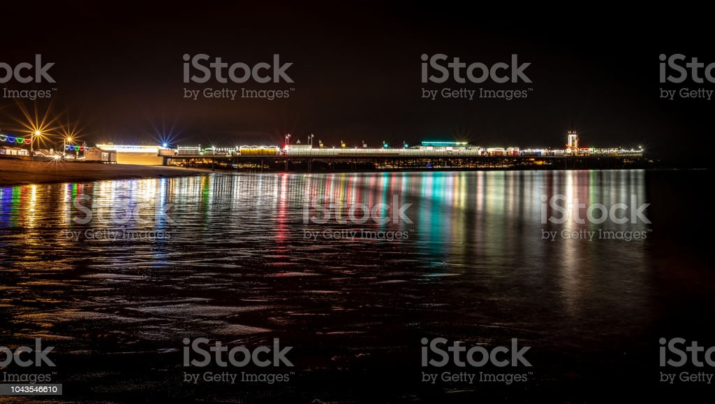 Paignton seafront and pier at night stock photo