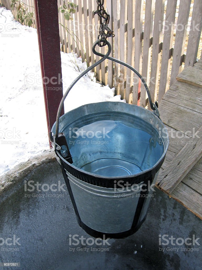 Pail above an well stock photo