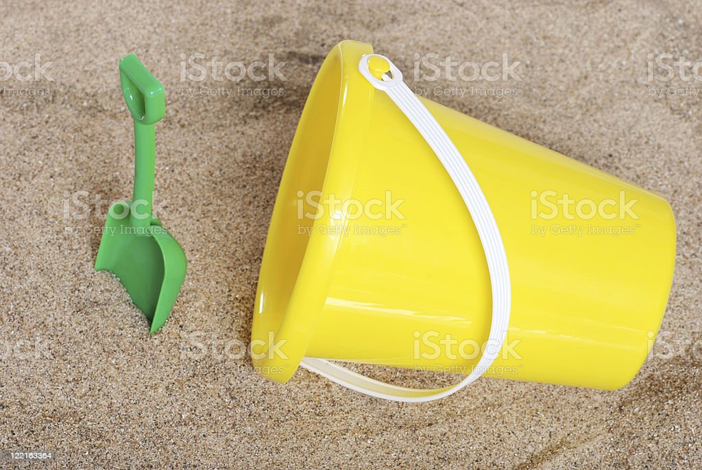 pail and shovel in the sand stock photo