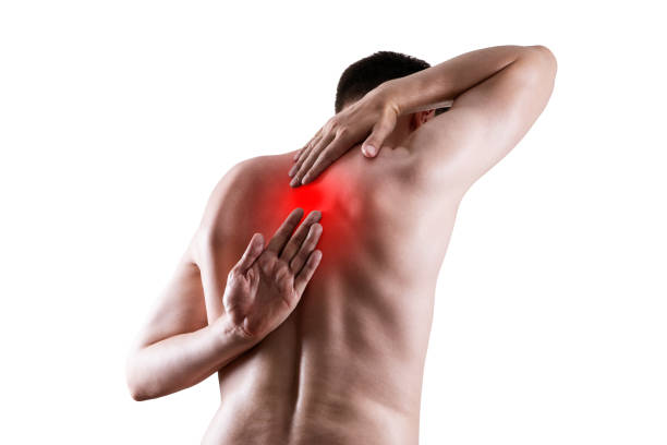 Pain between the shoulder blades, man suffering from backache isolated on white background stock photo