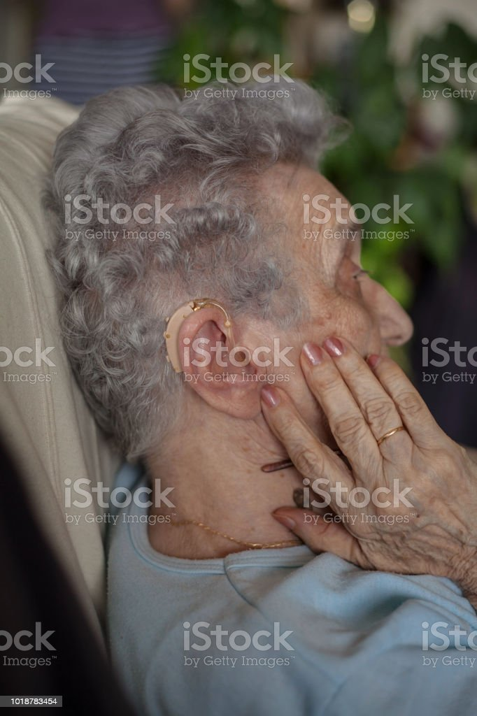 Pain comes from my ear. stock photo