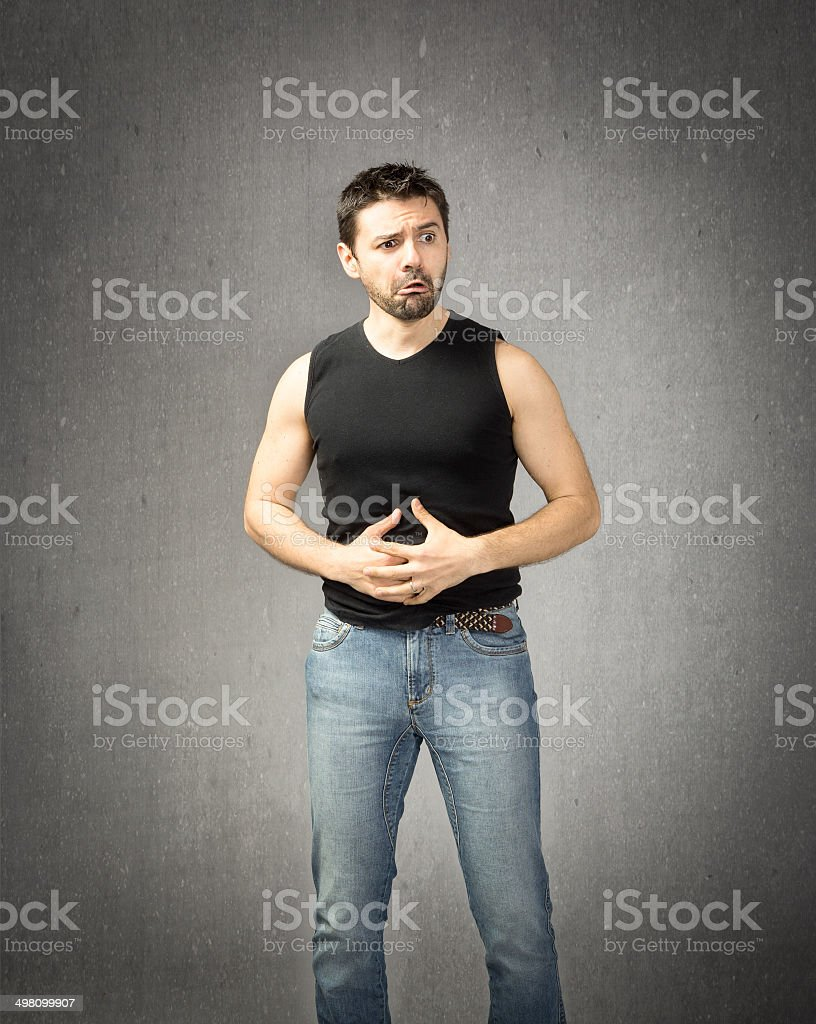 pain for a rude guy in black shirt royalty-free stock photo
