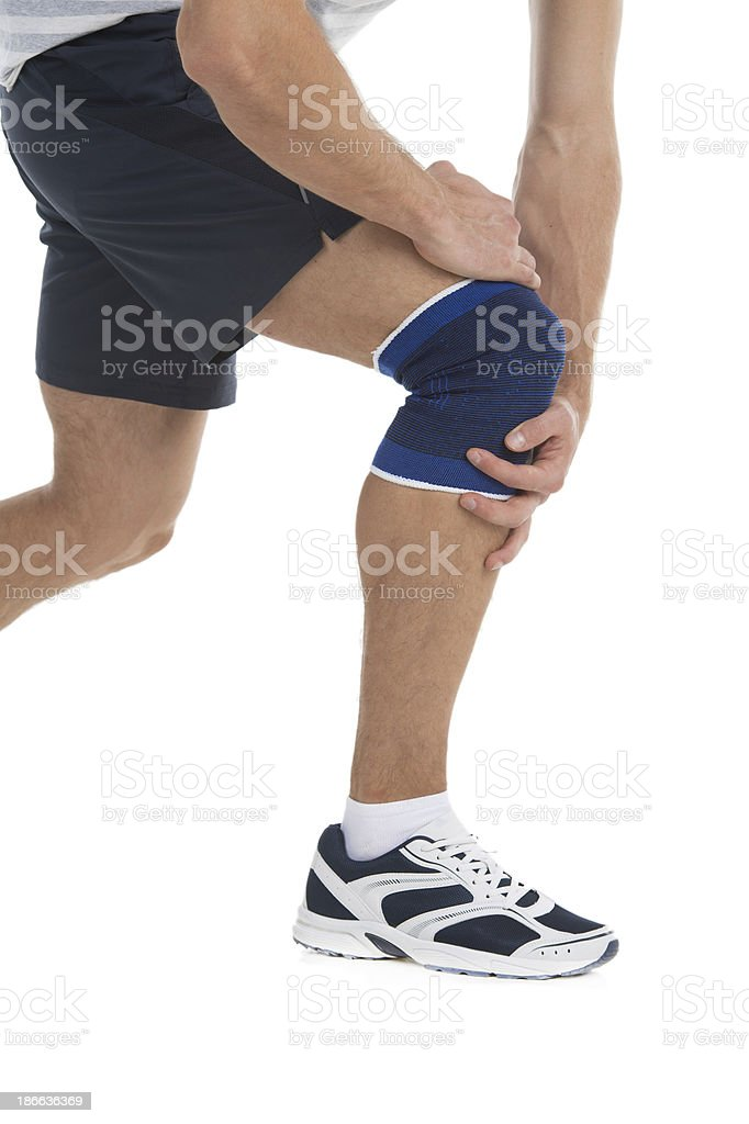 Pain in a knee stock photo