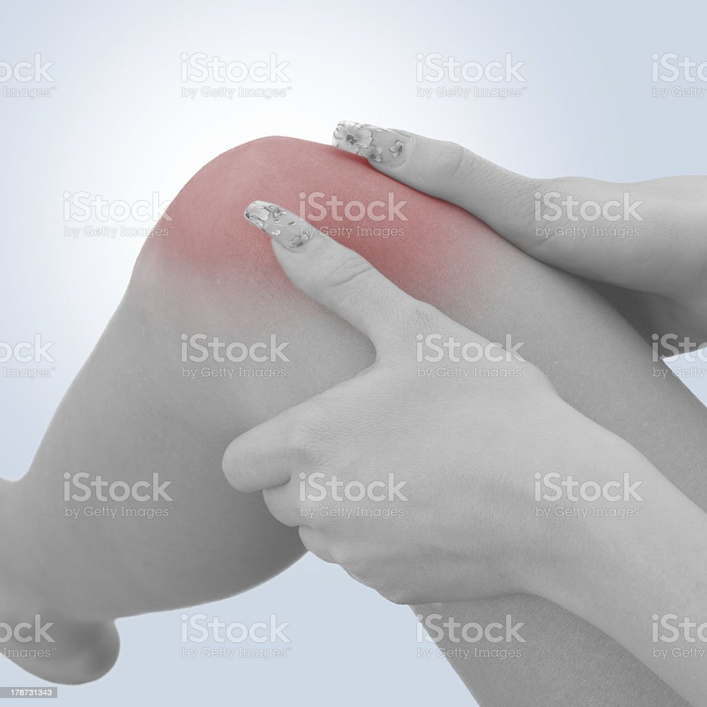 Pain in a woman knee royalty-free stock photo