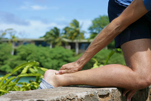 Pain in Achilles tendon stock photo