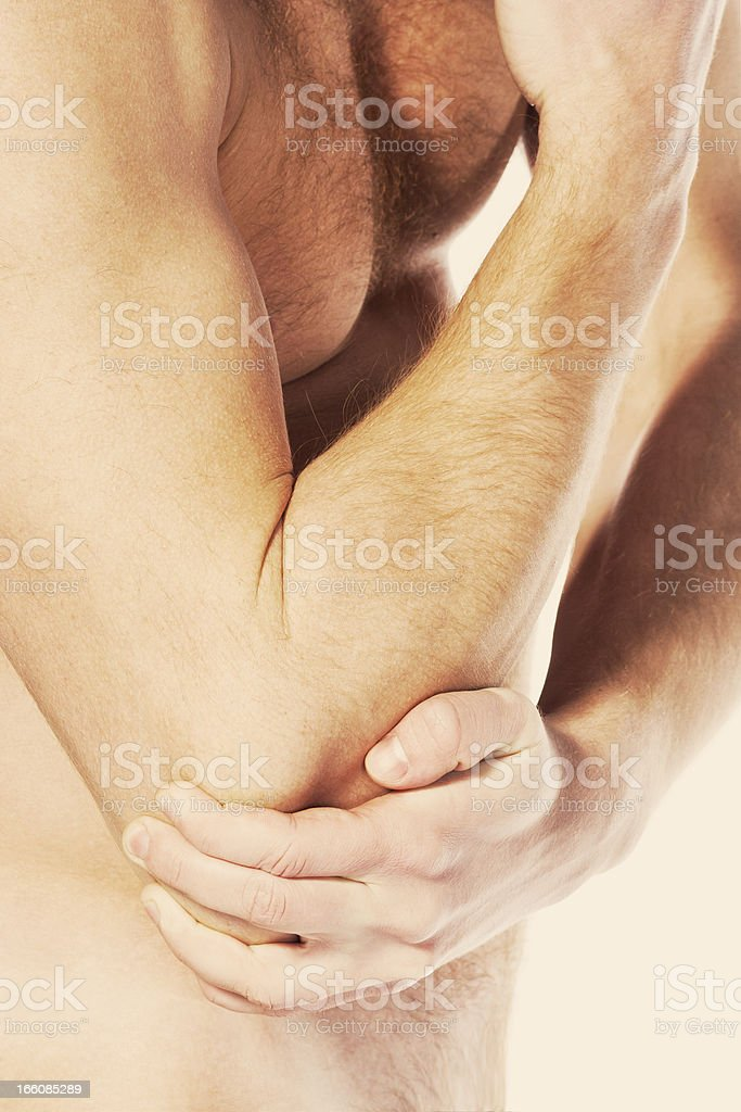 Pain in an elbow joint. sports trauma stock photo