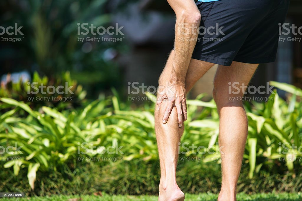 Pain in calf stock photo