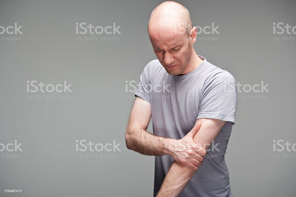 Pain in elbow stock photo
