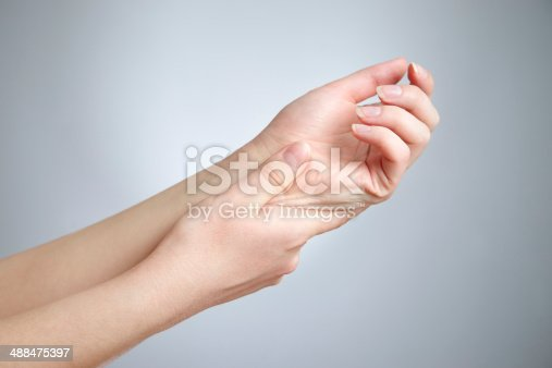istock Pain in joints of the hands 488475397