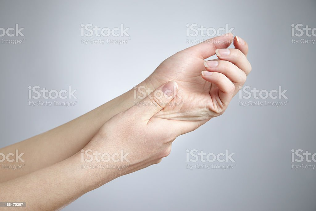Pain in joints of the hands stock photo