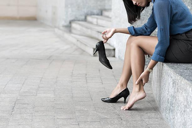 Dolor en las piernas - foto de stock