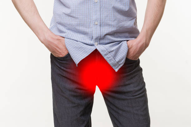 Pain in prostate, man suffering from prostatitis or from a venereal disease stock photo