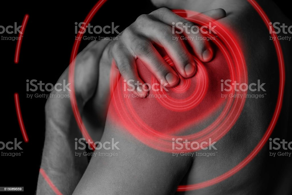 Pain in shoulder, painful area of red color stock photo